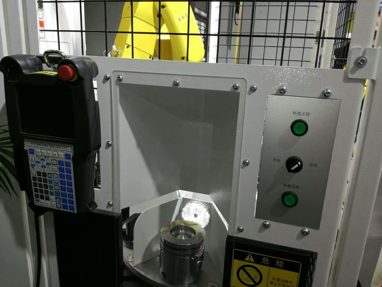 发动机活塞CNC加工中心自动上下料机器人生产线案例图片3