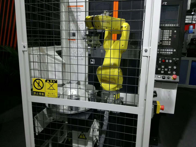发动机活塞CNC加工中心自动上下料机器人生产线案例图片1